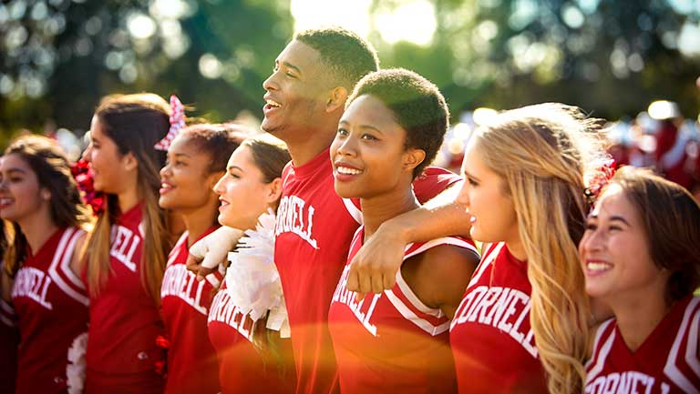 Cornell cheerleaders standing in a line